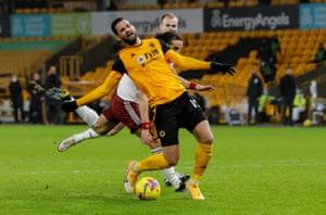 David Luiz of Arsenal fouls Willian Jose of Wolverhampton Wanderers and gives away a penalty.