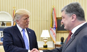 Donald Trump shakes hands with Ukraine's president, Petro Poroshenko.