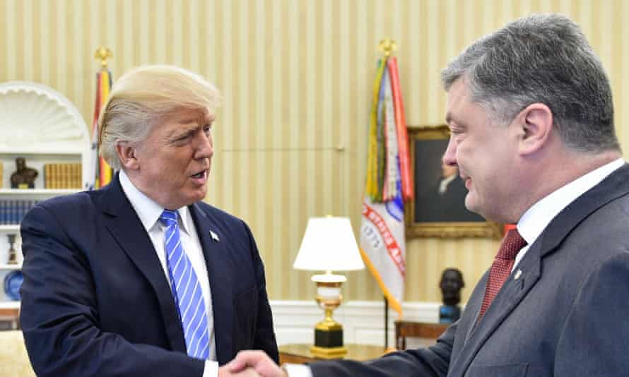 Donald Trump shakes hands with Ukraine's president, Petro Poroshenko.