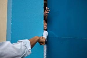 20 March, 2011  the president fist-bumps a young boy in Rio de Janeiro