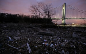 Debris sits on a still-closed beach area damaged by flooding from Hurricane Sandy near the Verrazano-Narrows Bridge on March 1, 2013 in the Staten Island borough of New York City.