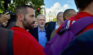 The new leader of the Labour Party Jeremy Corbyn is surrounded after addressing the 'Solidarity With Refugees' rally in London.