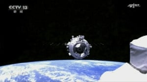 The docking process in space between the Tianhe core module of China's space station and a Shenzhou-12 spaceship carrying the crew of Chinese astronauts