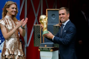 Former Germany captain Philipp Lahm brings out the World Cup trophy prior to the match. In around two hours' time, either France or Croatia will be crowned the best international footballing side in the world.