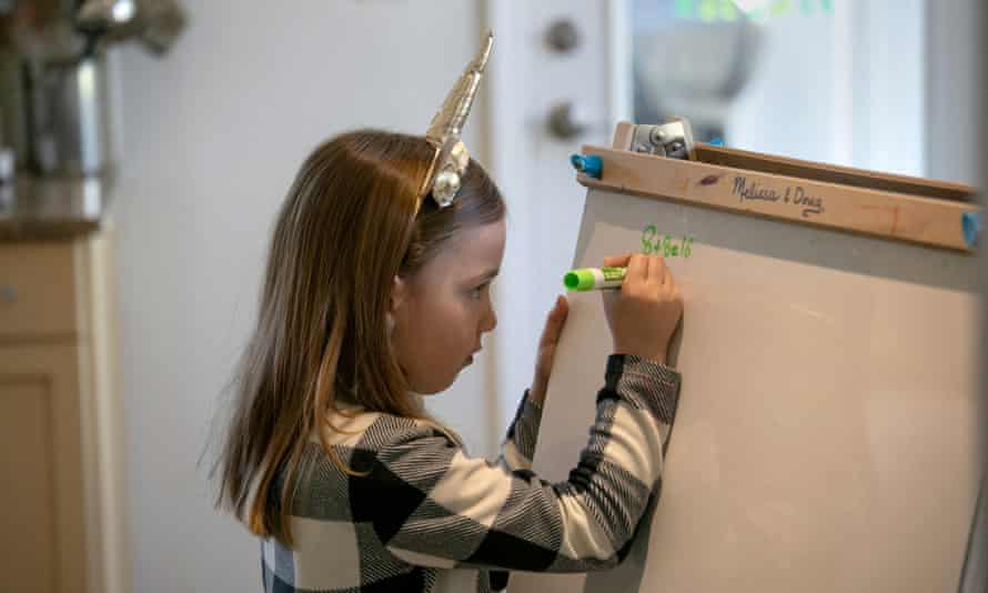 A girl learns maths at home during the Covid-19 lockdown.
