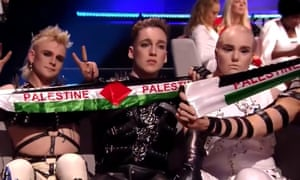 Iceland's entry, Hatari, hold up Palestine scarves as Eurovision results are announced.