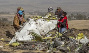 Rescuers work at the scene of an Ethiopian Airlines flight crash outside of Addis Ababa, Ethiopia on 11 March 2019.