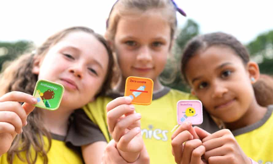 Guides and Brownies from the 22nd Walthamstow unit in London reveal three of the new badges.