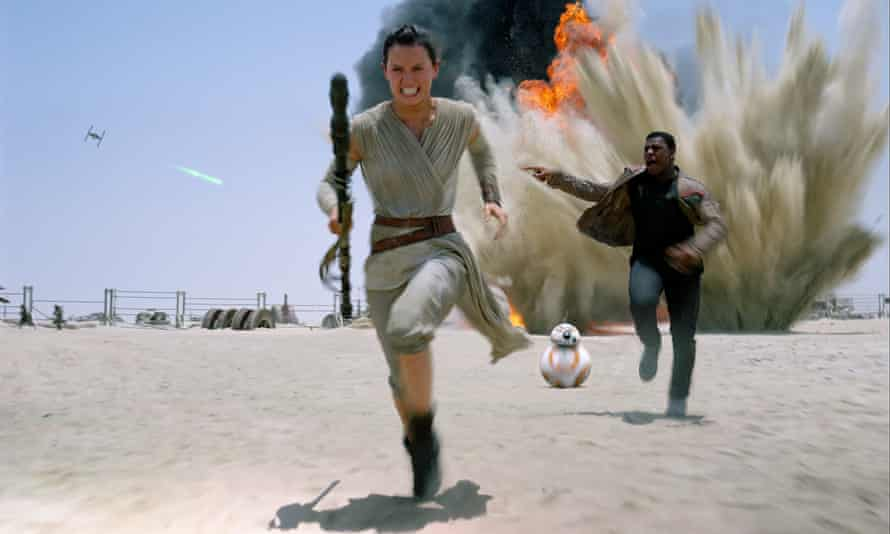 Actors Daisy Ridley and John Boyega in Star Wars VII: The Force Awakens