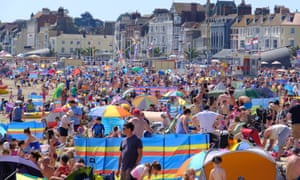Holidaymakers packed on to the beach at Weymouth.