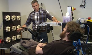 Researcher Rob Gaunt prepares Nathan Copeland for a brain computer interface sensory test.