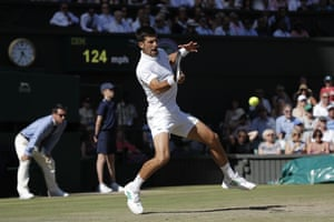 Novak Djokovic fires a forehand to Ernests Gulbis.