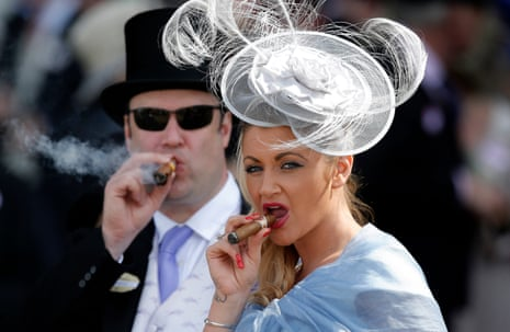 A lady with cigar in the Royal Enclosure during day three of Royal Ascot