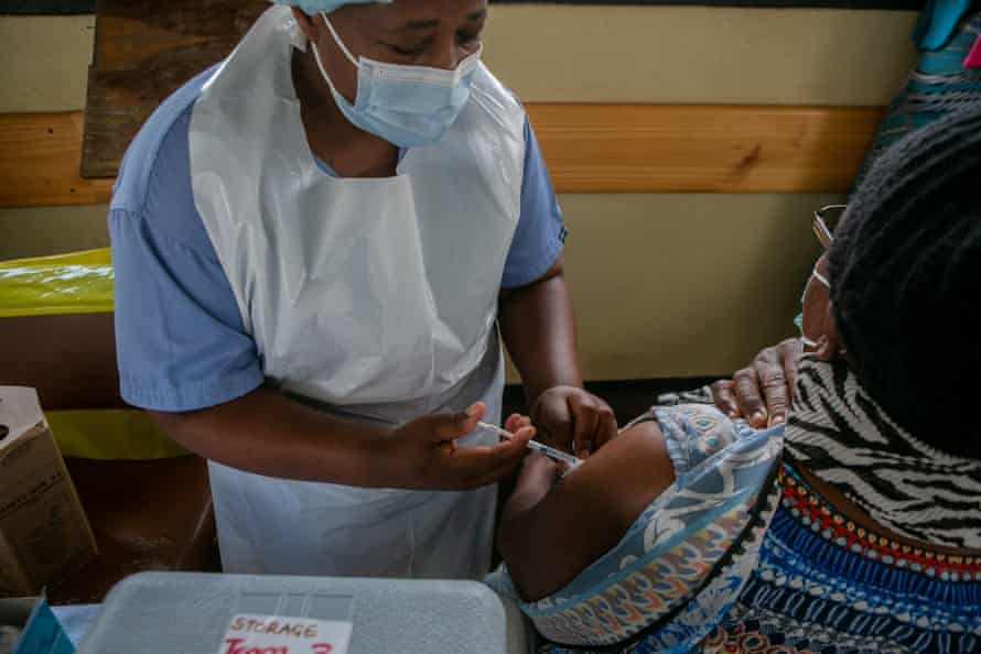 An elderly woman in vaccinated at a local hospital on 29 March in Harare, Zimbabwe.