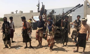 Yemeni pro-government forces gather during their fight against Houthi rebels.
