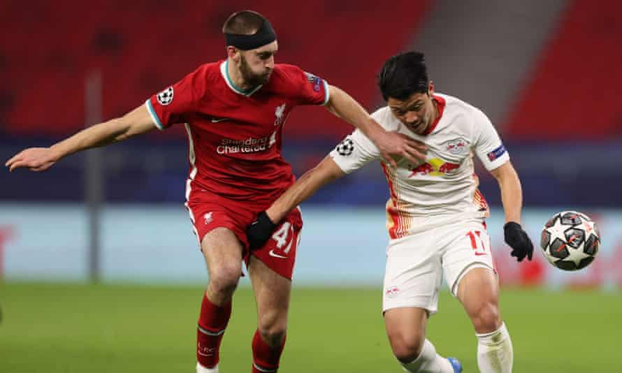Nat Phillips holds off Hwang Hee-chan of RB Leipzig during Liverpool's comfortable Champions League win over the German side last week.