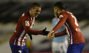 Atletico Madrid's Belgian midfielder Yannick Ferreira Carrasco (R) celebrates with teammate French forward Antoine Griezmann after scoring during the Spanish league football match RC Celta de Vigo vs Club Atletico de Madrid at the Balaidos stadium in Vigo on January 10, 2016. Atletico won the match 2-0. AFP PHOTO/ MIGUEL RIOPAMIGUEL RIOPA/AFP/Getty Images