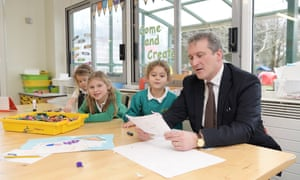 Damian Hinds with pupils at Holme primary school in Bordon, Hampshire