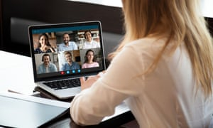 Back view of woman talking on video call with businesspeople