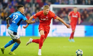 Erling Braut Haaland of Red Bull Salzburg, here being chased by Napoli's Giovanni Di Lorenzo, has lit up the Champions League group stage.