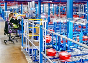 Conveyor belts ferry crates to human pickers at Ocado