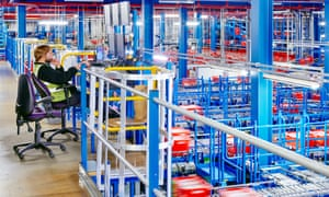 Automated grocery shopping being picked at an Ocado warehouse.
