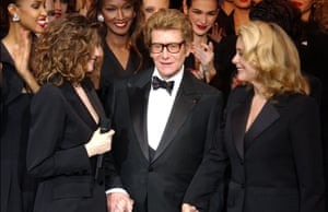 Saint Laurent was always surrounded by glamorous women. Here, for his last couture show in 2001, he takes his bow with Laetitia Casta and Catherine Deneuve. The show reduced the audience to tears. No surprise there. After all, the assembled fashion crowd had watched the designer change fashion over his more than 60-year career.