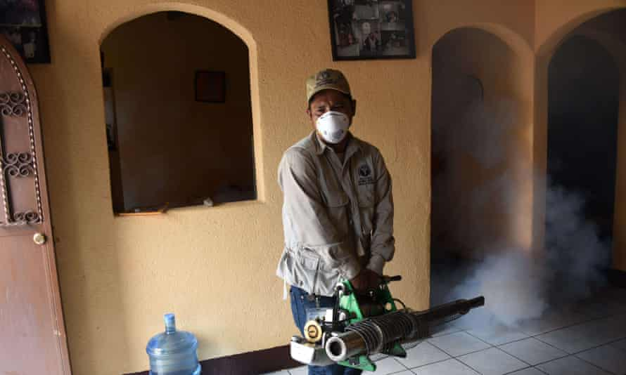 Health ministry employees fumigate against the Aedes aegypti mosquito, vector of the dengue, Zika and Chikungunya viruses, in Guatemala City.
