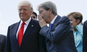 Italian Premier Paolo Gentiloni talks to U.S. President Donald Trump during a G7 summit in Taormina, Italy, Saturday, May 27, 2017. Perhaps he's whispering that climate change is real and withdrawing from the Paris treaty is a stupid idea.