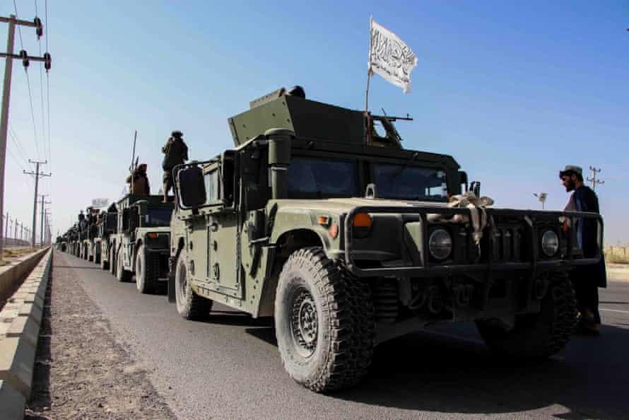 A long lines of green vehicles outside Kandahar.