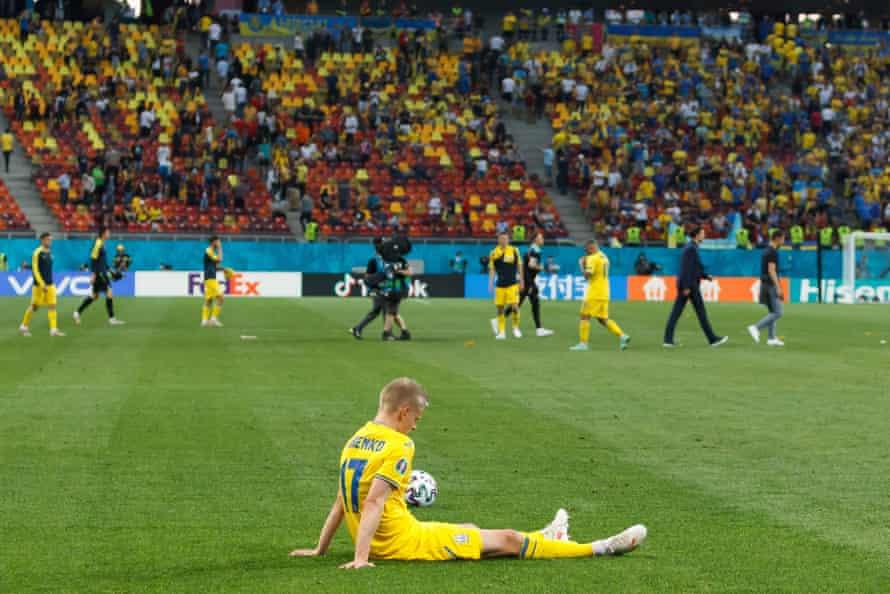 Oleksandr Zinchenko of Ukraine looks dejected after losing to Austria