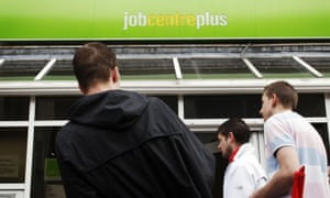 People stand outside a jobcentre in Chatham