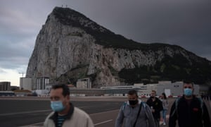The rock of Gibraltar. People cross the Spanish border of the British overseas territory of Gibraltar on November 24, 2020.