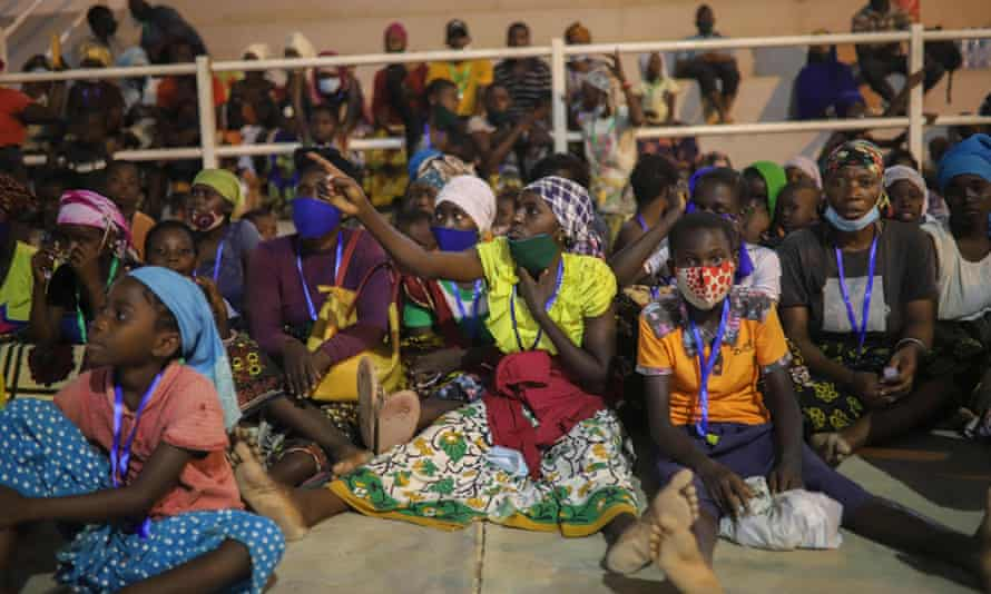 Internally displaced people from Palma gather in a sports centre in Pemba to receive humanitarian aid