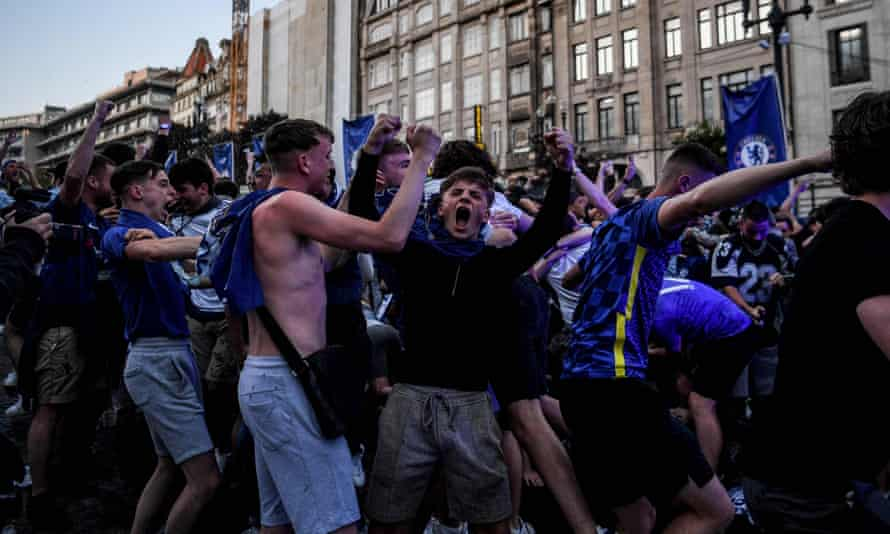 Chelsea supporters celebrate as they watch the Champions League final in a fan zone in Porto.