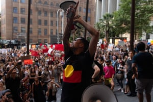 Activist Gavin Stanbrook addresses a crowd assembled outside the Commonwealth Parliament Offices at a climate action rally in Sydney