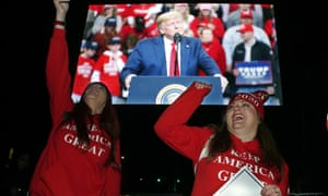 Trump supporters cheer during a live feed outside the rally.