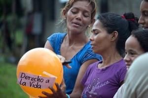 Residents of the Villa Fanny neighbourhood in Fundación, Colombia, take part in a workshop on women's rights. The sign on the balloon reads: 'right to life'.