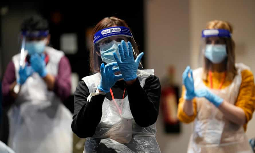 Covid vaccine volunteers are trained in the correct use of PPE.
