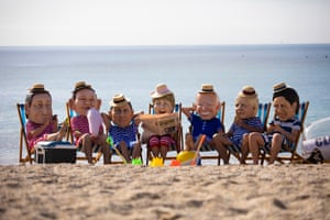 Oxfam campaigners wearing costumes depicting G7 leaders on Swanpool Beach near Falmouth, Cornwall.