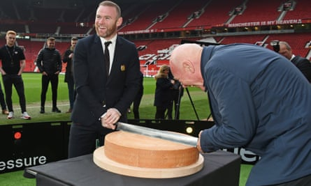 Wayne Rooney slices some cheese with the CEO of Tag Heuer, Jean-Claude Biver, at an Old Trafford commercial launch on Wednesday.