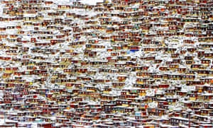 Hundreds of red houses of the lamas and nuns at the Larung Gar Buddhist Academy in Sichuan province, China, after heavy snowfall