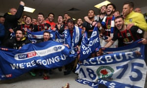 Blackburn Rovers' squad celebrate promotion in the dressing room after the game at Doncaster
