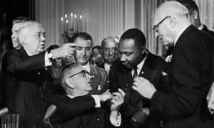 Lyndon B Johnson shakes the hand of Martin Luther King at the signing of the Civil Rights Act 1964