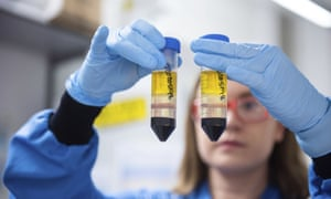 A researcher in a laboratory at the Jenner Institute in Oxford, England, works on the coronavirus vaccine developed by AstraZeneca and Oxford University.
