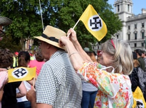 Ben Nicholson with his specially designed Trump flags in Parliament Square, London