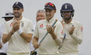 James Anderson the England captain, Joe Root,  and Ben Foakes celebrate sealing their Test series victory over Sri Lanka by winning the second Test.