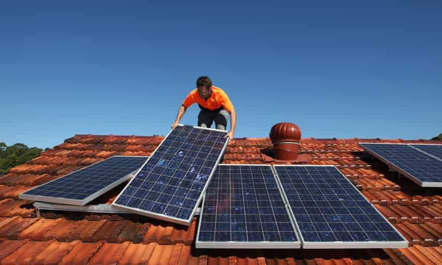Solar panels are being installed on the roof of a house in Sydney, Australia.