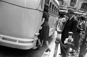 A queue to board a city bus