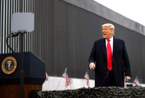 President Donald Trump yells as he visits the US-Mexico border wall in Alamo.